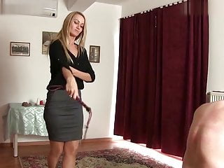 Mistress Demona relieves her stress by whipping on a slave