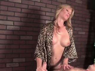 Experienced masseuse Tina plays with cock
