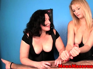 Masseuse teases while domina slaps in trio