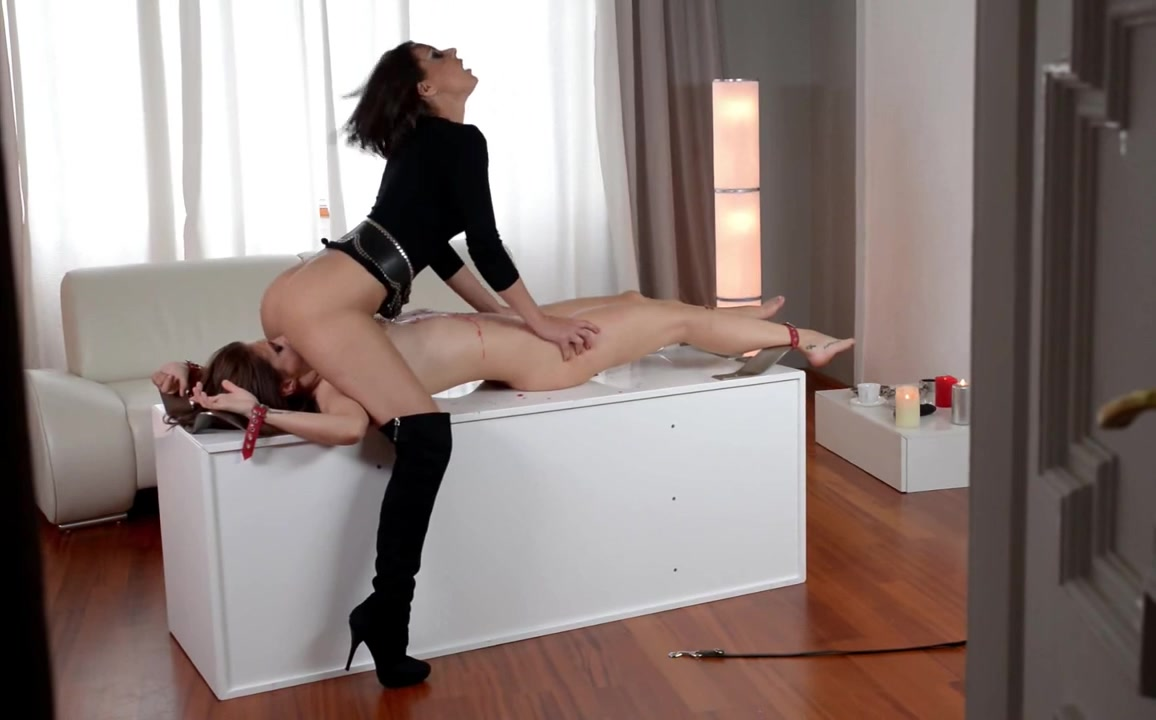 Tall dominatrix tortures her hot slave