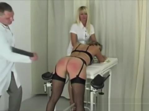 Brunette Flogged By Blonde Mistress