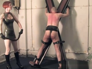 Femdom flogs scum sub on Saint Andrews Cross