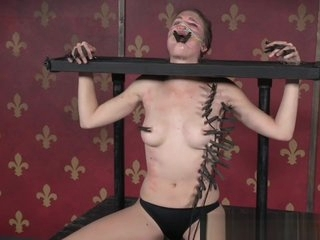 Humiliated babe getting restrained by femdom