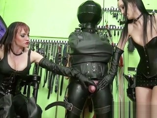 two mistresses in thigh high boots jerking off slave