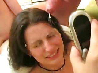 Talks on phone to her ex while getting bukkake