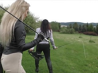 Riding Mistress trains ponyboys horsewhip