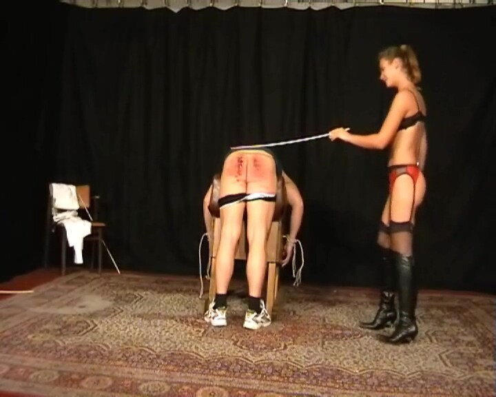 Undressing domina giving a severe long cruel caning