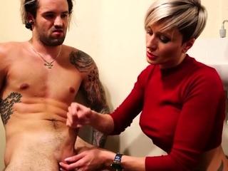 Tattooed CFNM babe enjoys dick wanking session