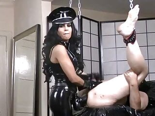 Mistress latex fisting and strap-on